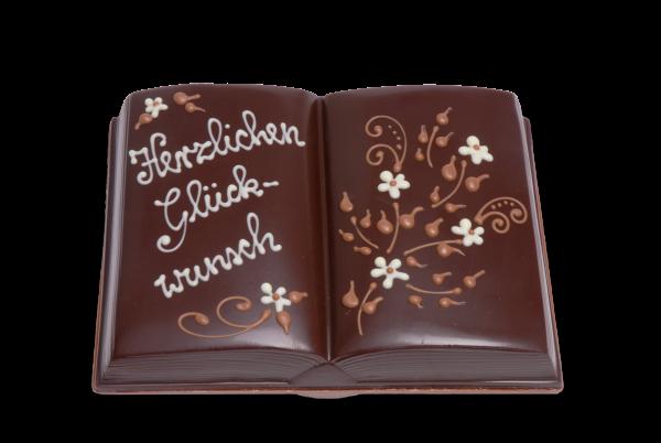 Schokoladenbuch gefüllt mit Pralinen